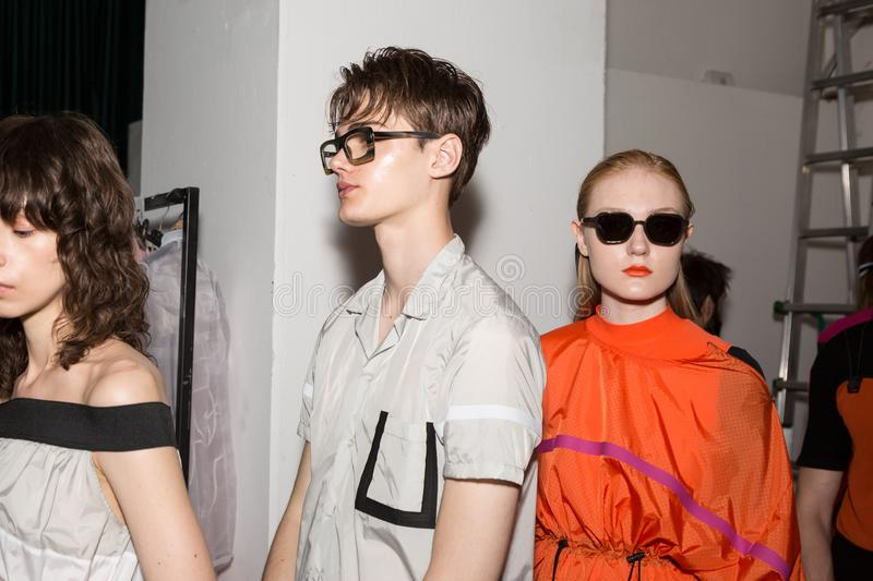 Beautiful models posing in the backstage. MILAN, ITALY - JUNE 17: Beautiful models pose in the backstage just before Edithmarcel show during Milan Men`s Fashion royalty free stock photos