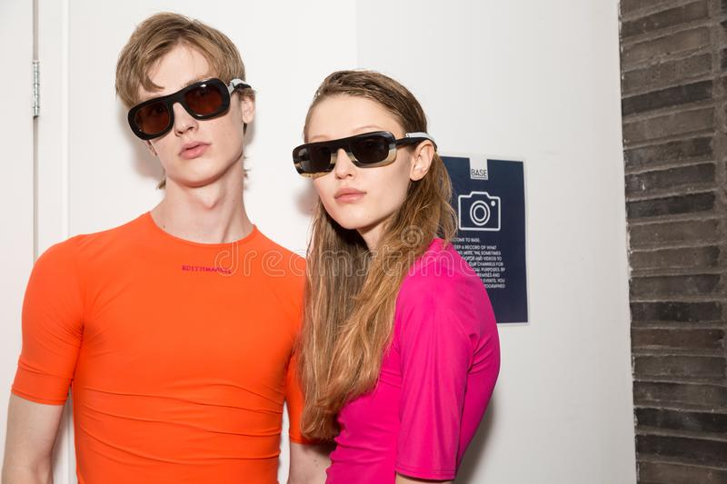 Beautiful models posing in the backstage. MILAN, ITALY - JUNE 17: Beautiful models pose in the backstage just before Edithmarcel show during Milan Men`s Fashion royalty free stock images