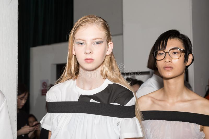 Beautiful models posing in the backstage. MILAN, ITALY - JUNE 17: Beautiful models pose in the backstage just before Edithmarcel show during Milan Men`s Fashion stock photos