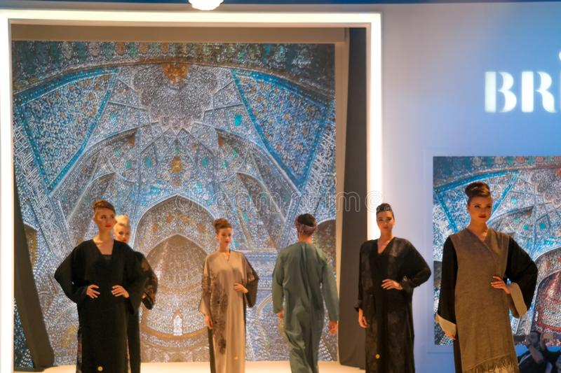 Beautiful models posing catwalk on stage showing traditional Arabic eastern wedding and bridal dresses royalty free stock photography
