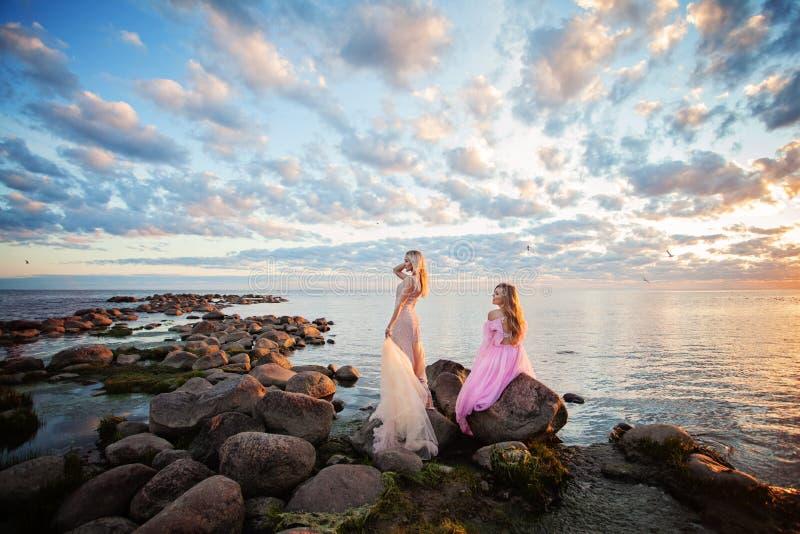 Beautiful Models Woman on Sunset Coast Outdoors. Fashion Blonde Women royalty free stock photo