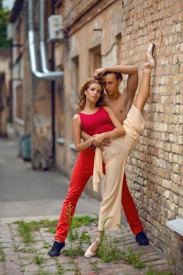 Beautiful modern ballet couple dancing in summer outdoors royalty free stock photos