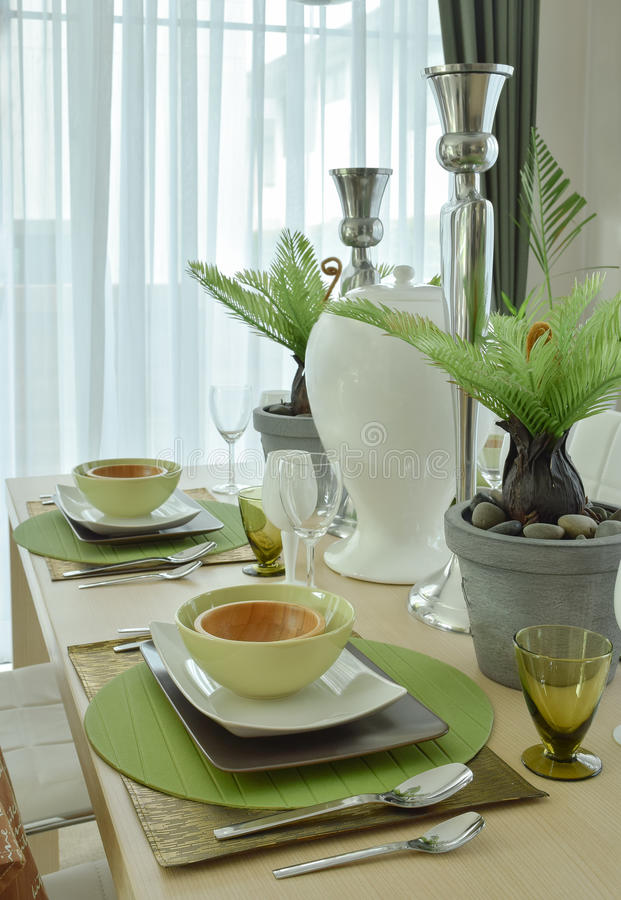 Beautiful modern ceramic tableware in green color scheme stock photography
