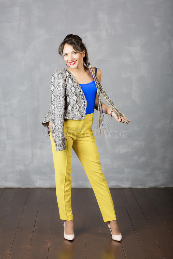 Beautiful modern girl wears fashionable clothes. stock image