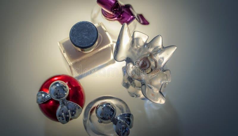 Beautiful modern glass bottles for women`s perfume. Modern glass bottles for women`s perfume royalty free stock image