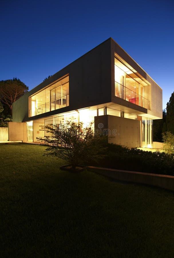 Beautiful modern house outdoors at night royalty free stock photos