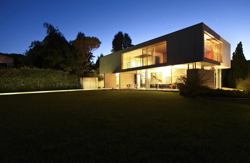 Beautiful modern house outdoors at night royalty free stock photos