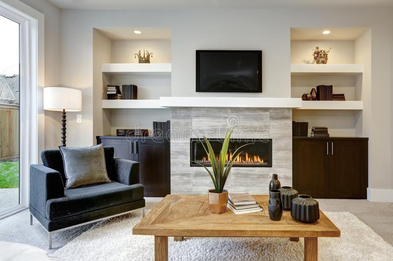 Beautiful modern living room interior with stone wall and fireplace in luxury home.  stock photos