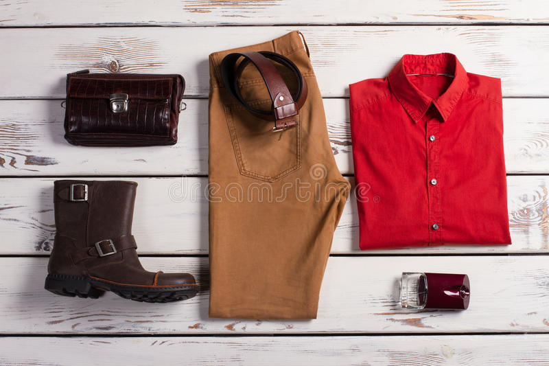 Beautiful modern set of casual menswear. Clothing and accessories on a wooden background stock photos