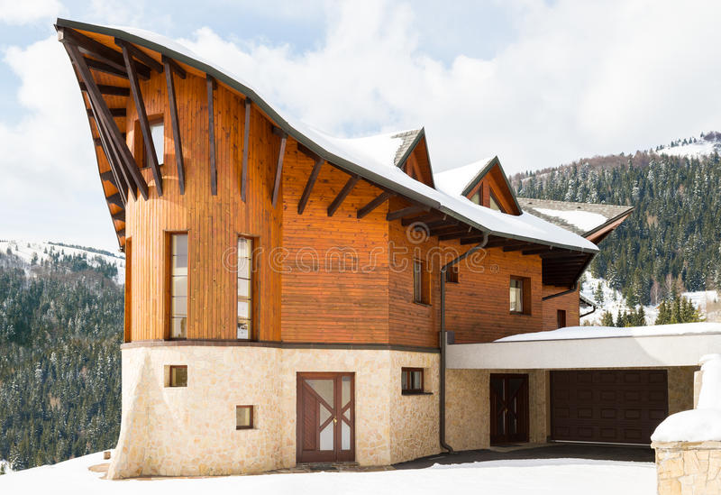 Beautiful modern wooden house covered in snow, ski resort Donovaly. Slovakia royalty free stock photo