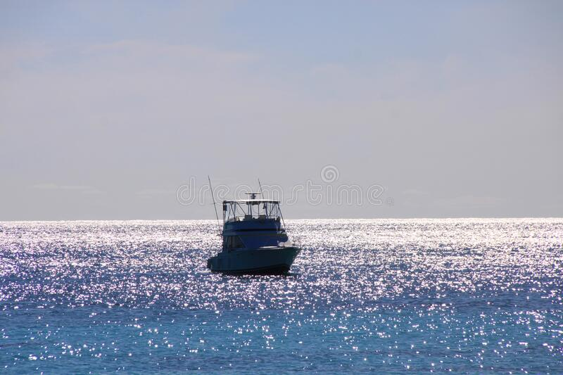 Beautiful modern yacht, ship at sea with tourists on a board. Beautiful modern yacht, ship at sea with tourists on a blue sky stock image