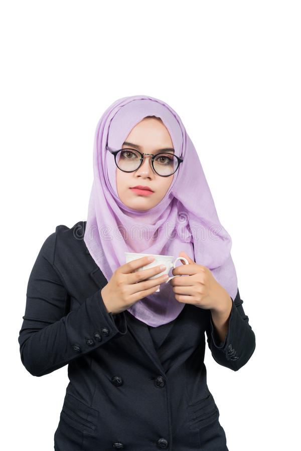 Beautiful modern Young Asian Muslim business woman holding a white coffee cup. royalty free stock photos