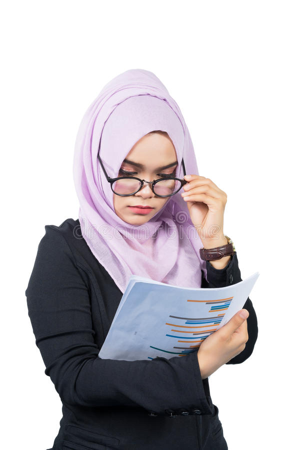 Beautiful modern Young Asian Muslim business woman looking the reports, stock images