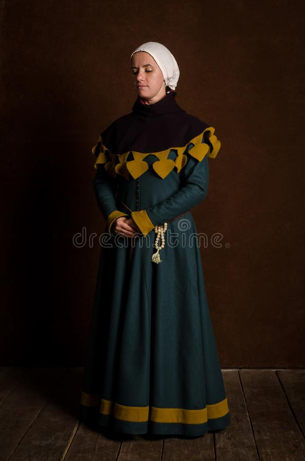 Beautiful modest girl in a medieval dress with a hood royalty free stock photos