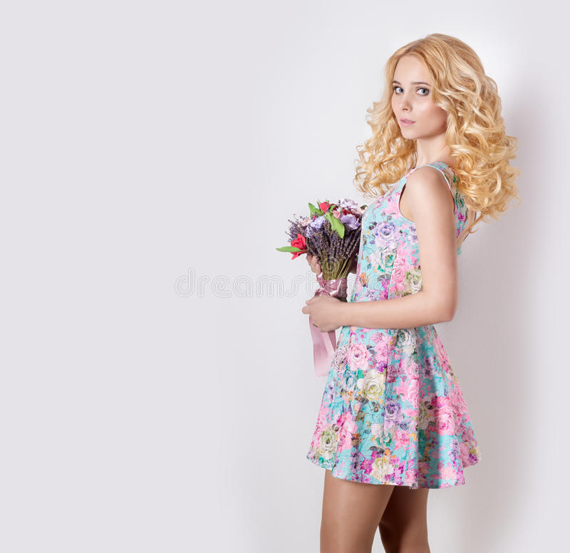 Free Beautiful Modest Sweet Tender Girl With Curly Blond Hair Standing On White Background With A Bouquet Of Flowers Of Lavender Stock Images - 53393804