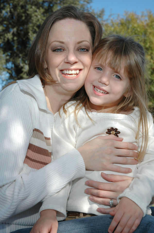 Beautiful Mom and Daughter. A cute little four year old girl and her mommy pose together. Spending time together with mom and daughter stock photos