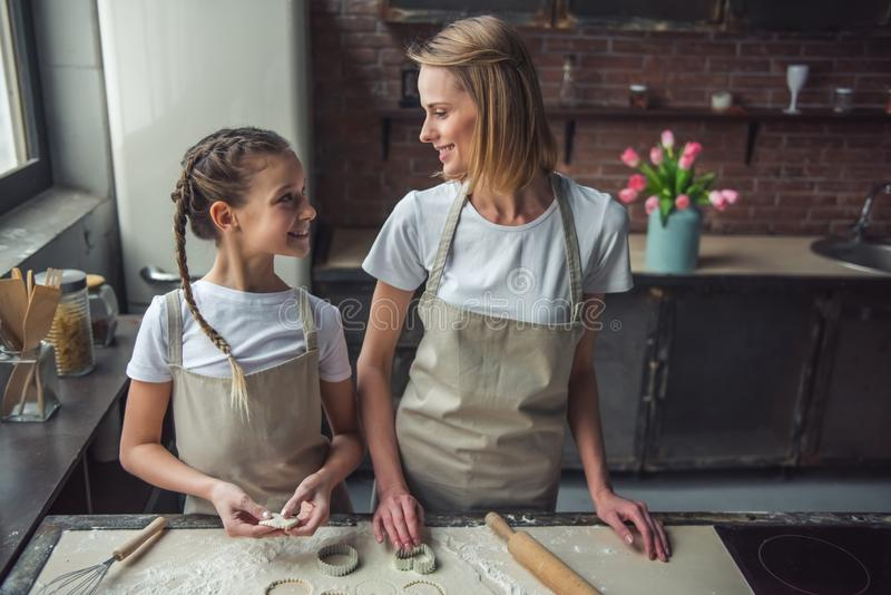 Mom and daughter baking stock photo