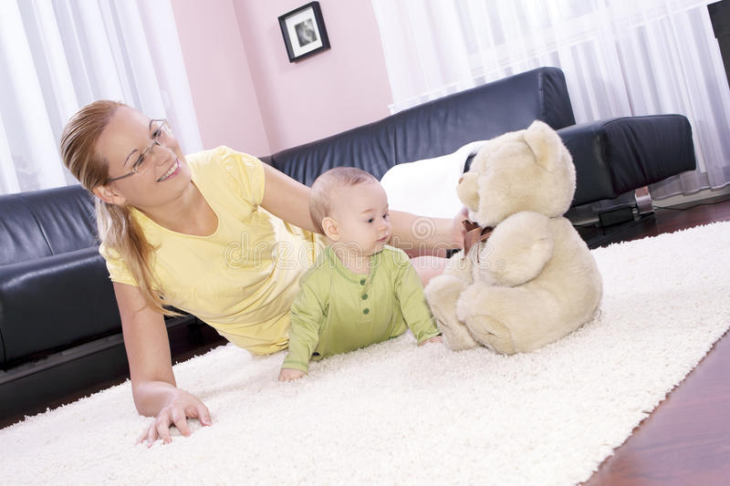 Download Beautiful Mom With Her Son Playing Happily. Stock Photo - Image: 20569568