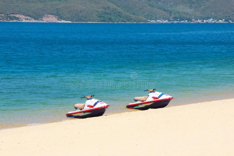 Two hydroscooters are on the beautiful beach stock images
