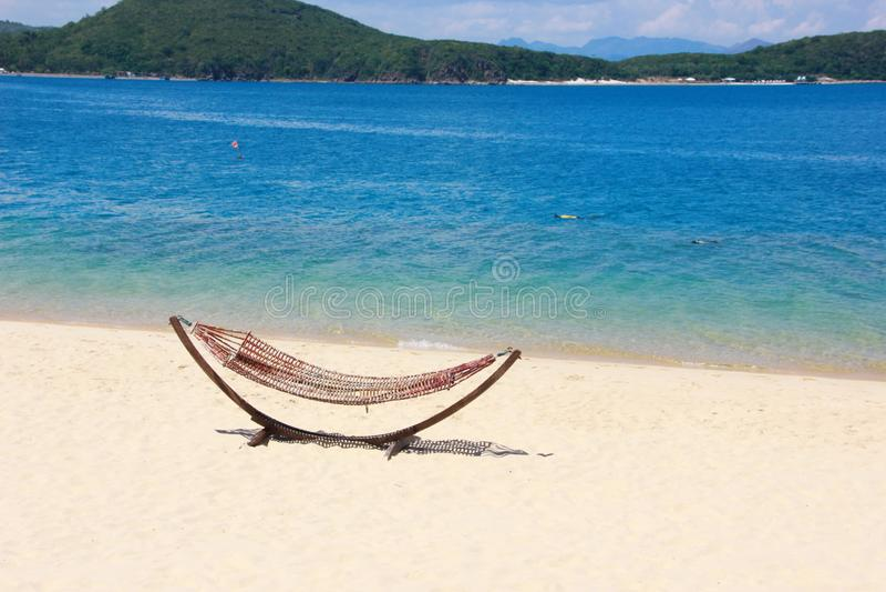 Wattled  hammock on the sandy beach near the sea. stock images