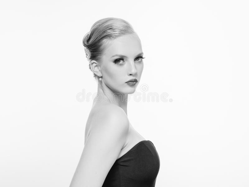 Beautiful monochrome woman beauty portrait in classic style isolated on white monochrome. Studio shot stock photography