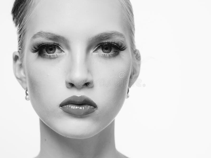 Beautiful monochrome woman beauty portrait in classic style isolated on white monochrome. Studio shot stock image