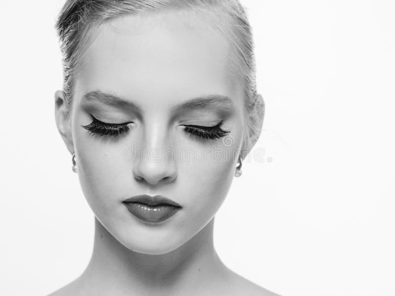 Beautiful monochrome woman beauty portrait in classic style isolated on white monochrome. Studio shot stock photo
