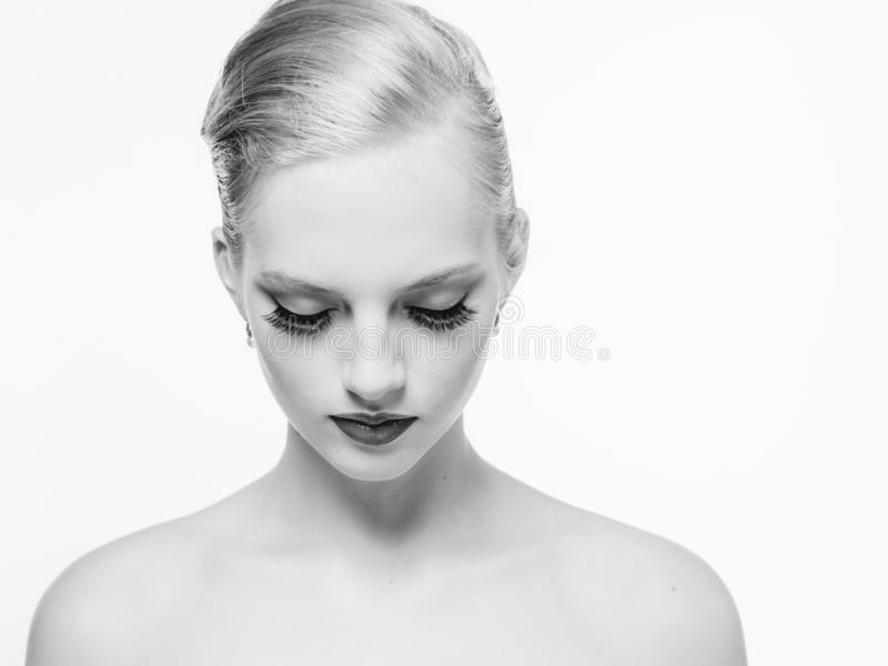 Beautiful monochrome woman beauty portrait in classic style isolated on white monochrome. Studio shot royalty free stock image