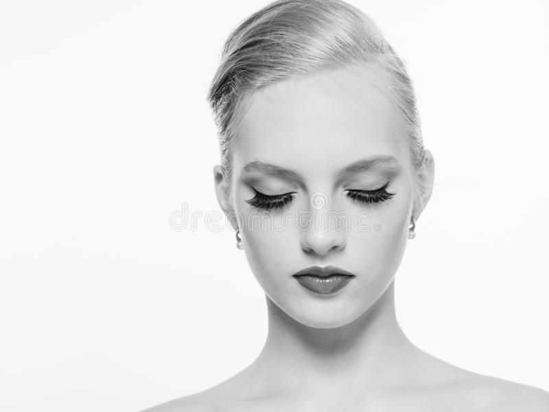 Beautiful monochrome woman beauty portrait in classic style isolated on white monochrome. Studio shot royalty free stock photography