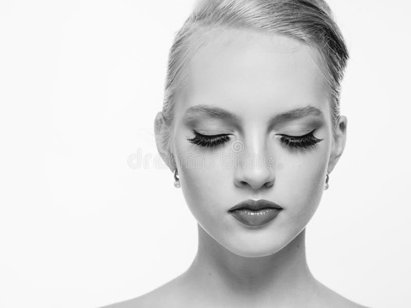 Beautiful monochrome woman beauty portrait in classic style on white monochrome. Studio shot stock photos