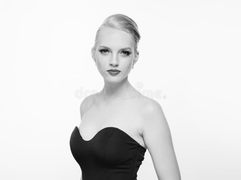 Beautiful monochrome woman beauty portrait in classic style on white monochrome. Studio shot stock image