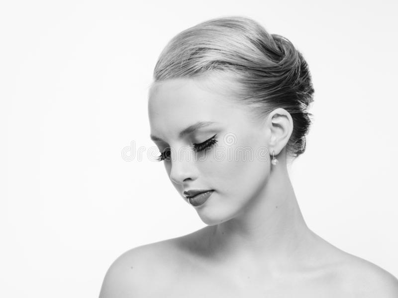 Beautiful monochrome woman beauty portrait in classic style on white monochrome. Studio shot royalty free stock photo