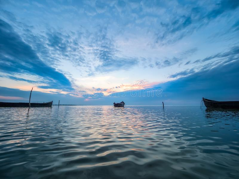 Beautiful morning landscape with boats on the lake at the sunrise stock images