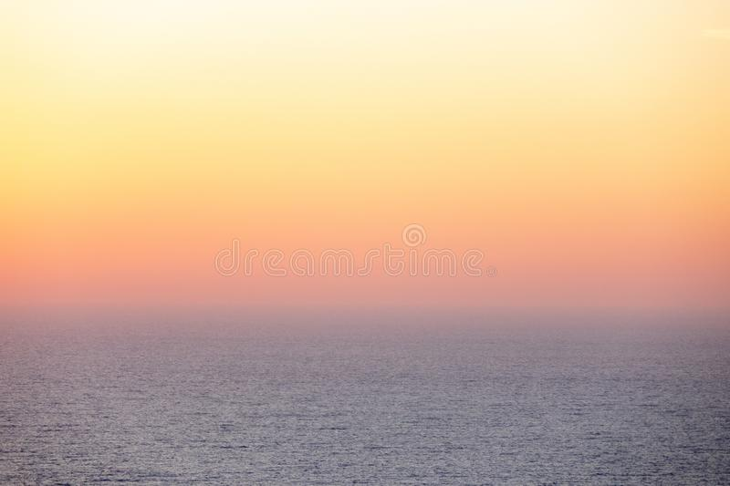 Beautiful morning sunset sky with soft blur pastels gradient background . Amazing sea landscape with a gentle soft sunrise with a pink haze against the rising royalty free stock photography
