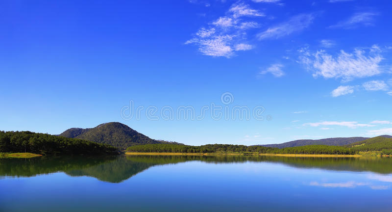 Morning landscape with clear mountain reflection in lake - Dalat, Vietnam royalty free stock photography