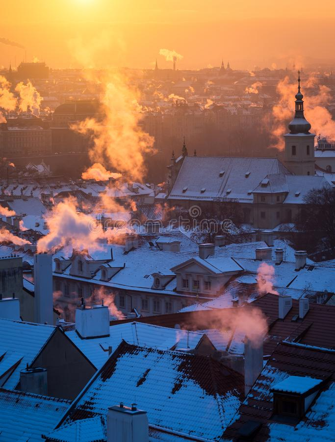 Free Beautiful Morning With Sun Rising Over The Prague Roofs Covered With Fresh Snow. Royalty Free Stock Photo - 135908795