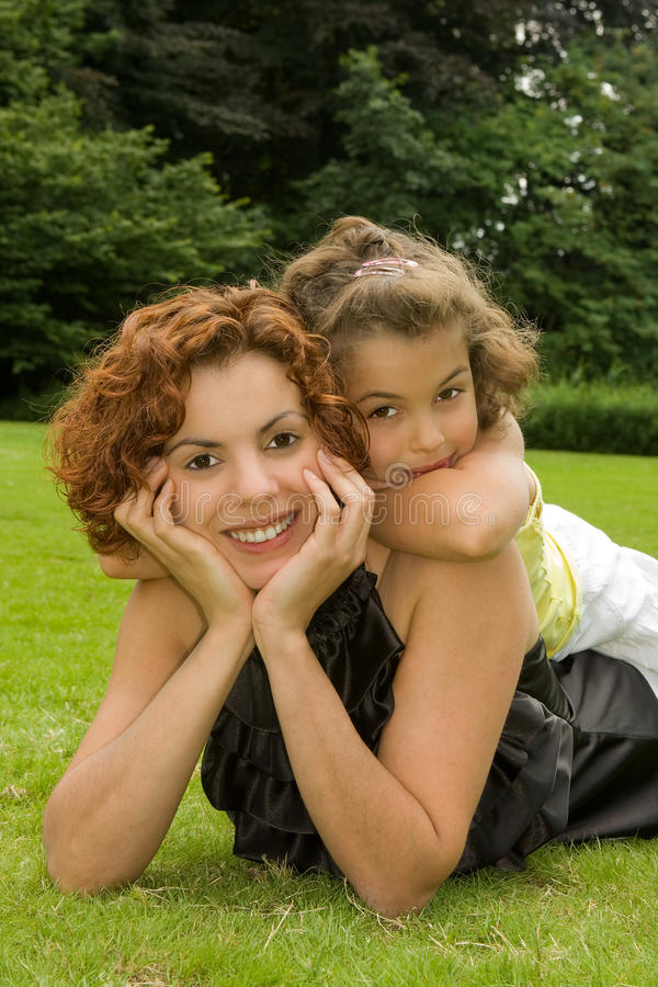 Beautiful mother. With her little girl in the park stock image
