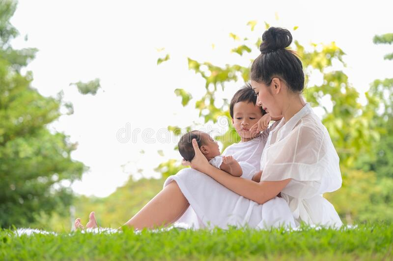 Beautiful mother and baby Family  in Asian park stock photography