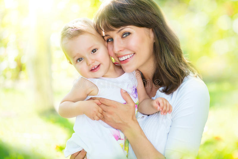 Beautiful mother and baby. Playing in a park stock photos