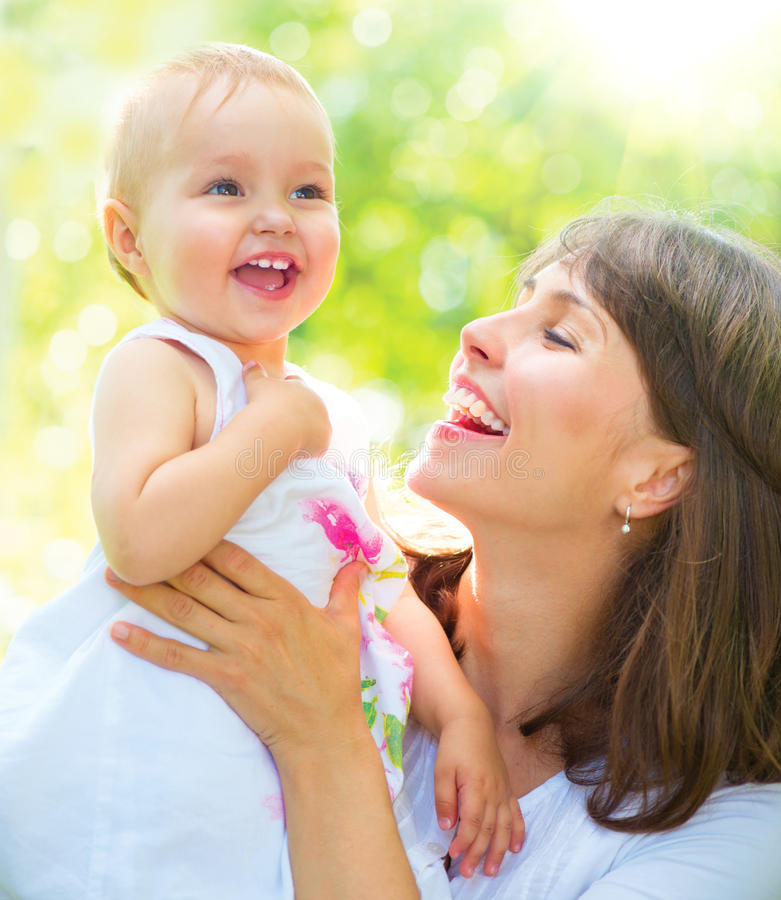 Beautiful mother and baby. Mother and baby playing in a park stock photos