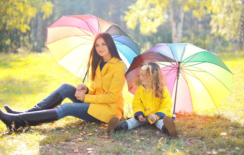 Beautiful mother and child with umbrella in autumn royalty free stock images