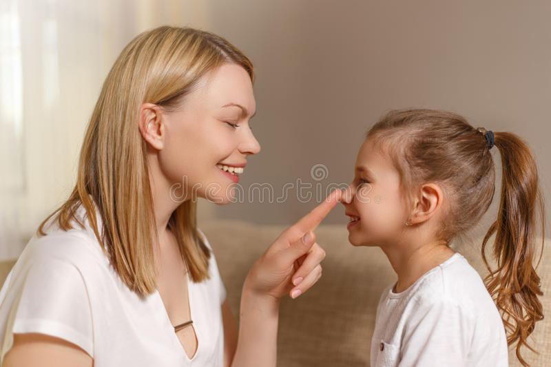 Beautiful mother is comforting his young frustrated daughter. royalty free stock images