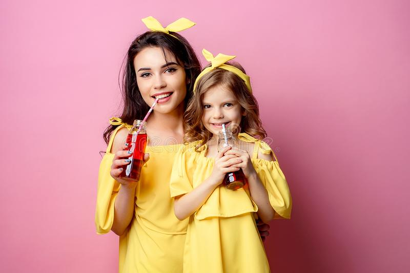 Beautiful mother with daughter drinking through straw stock photo