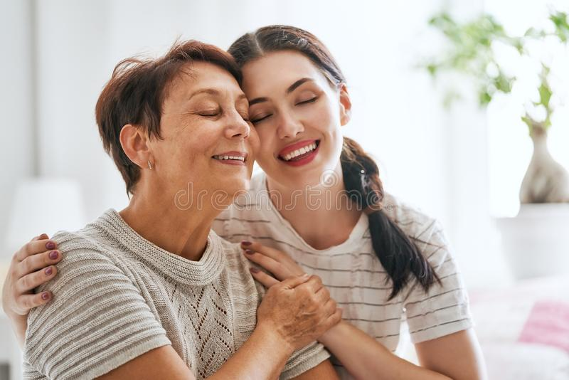 Mother and her adult daughter stock photos