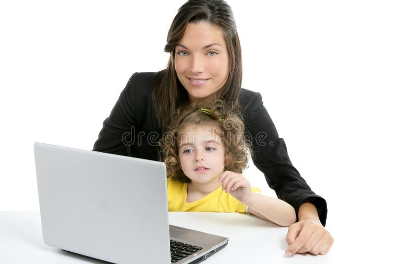 Beautiful mother and daughter laptop computer stock image