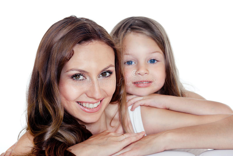 Beautiful mother and daughter. Portrait of young beautiful smiling mother and preschool daughter with blue eys stock photo