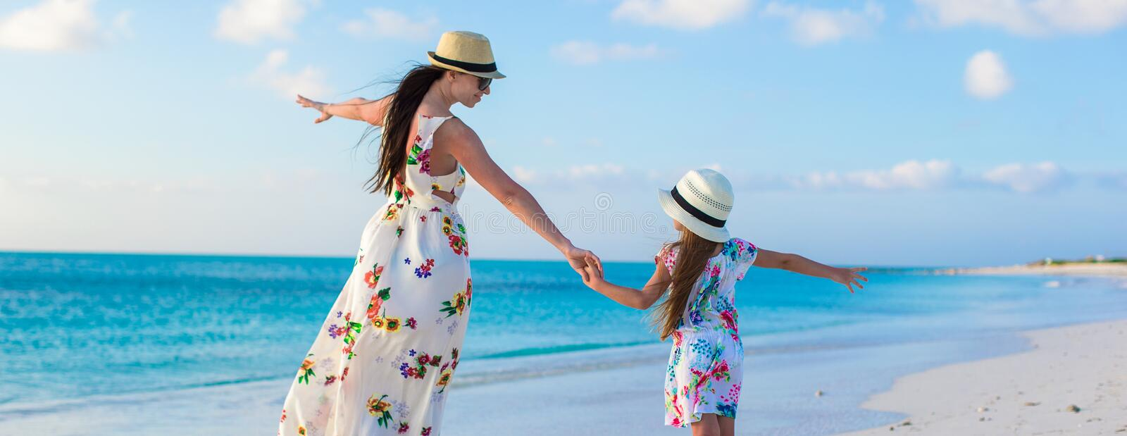 Beautiful mother and her adorable little daughter stock images
