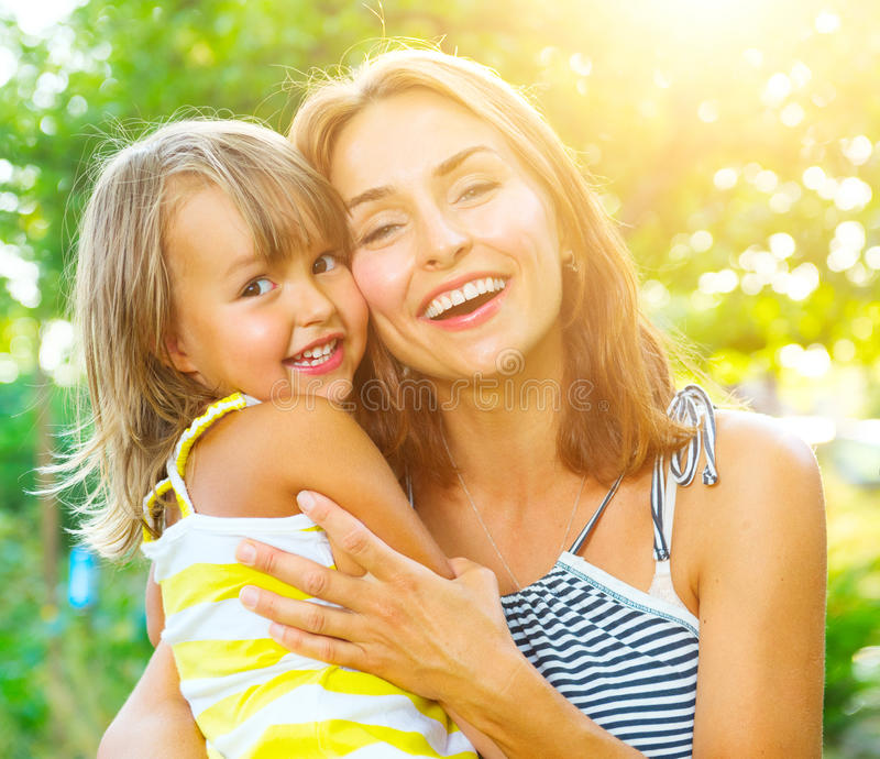 Beautiful mother and her little daughter. Outdoors royalty free stock photos
