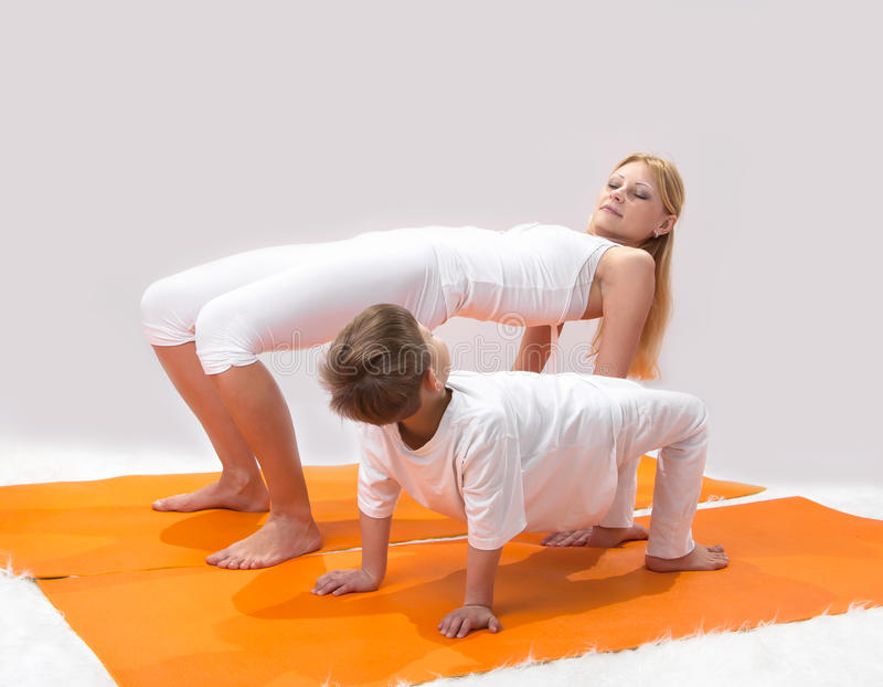 Download A Beautiful  Mother Practices Yoga With Her Son Stock Image - Image: 33261955