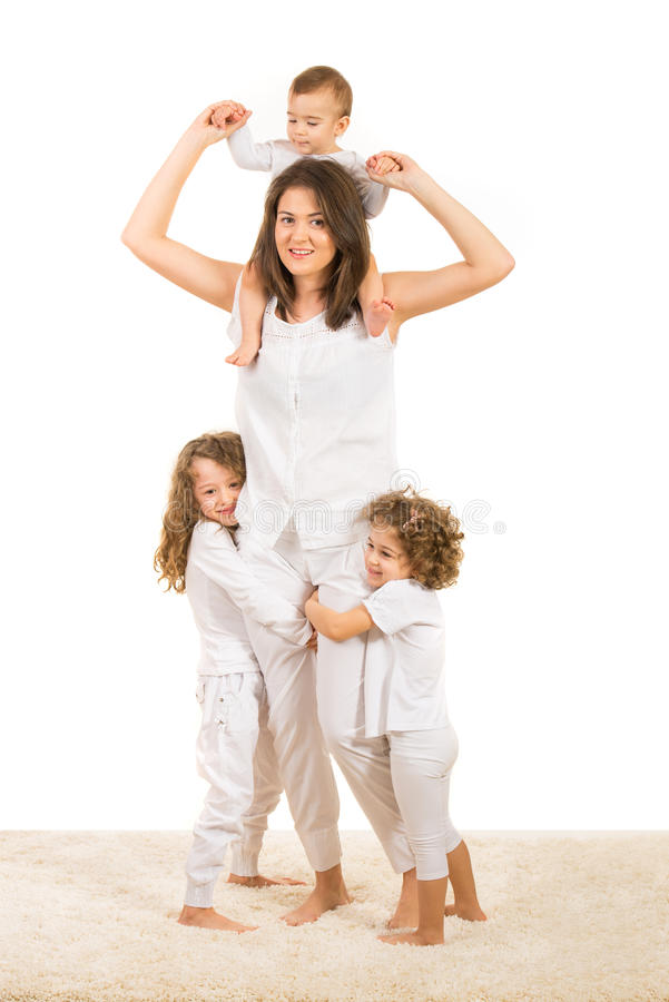 Beautiful mother with three kids stock images